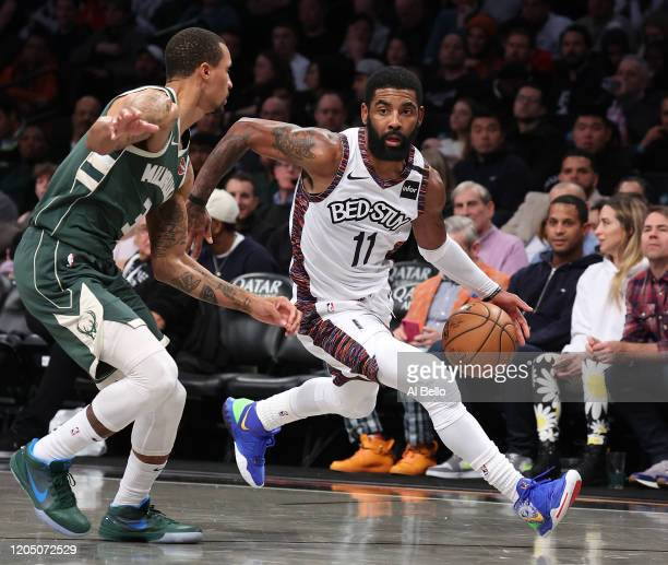 Kyrie Irving of the Brooklyn Nets dribbles against George Hill of the Milwaukee Bucks during their game at Barclays Center on January 18, 2020 in New...