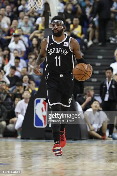 Kyrie Irving of the Brooklyn Nets dribbles during a preseason game as part of 2019 NBA Global Games China on October 10, 2019 at Mercedes Benz Arena...