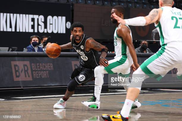 Kyrie Irving of the Brooklyn Nets dribbles the ball during the game against the Boston Celtics on March 11, 2021 at Barclays Center in Brooklyn, New...