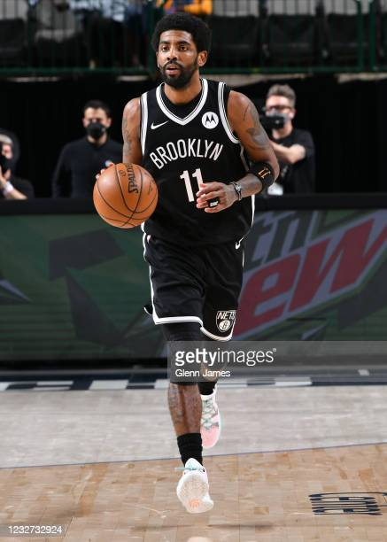 Kyrie Irving of the Brooklyn Nets dribbles the ball during the game against the Dallas Mavericks on May 6, 2021 at the American Airlines Center in...