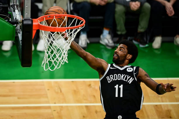 Kyrie Irving of the Brooklyn Nets drives to the basket against the Boston Celtics during Game Four of the Eastern Conference first round series at TD...
