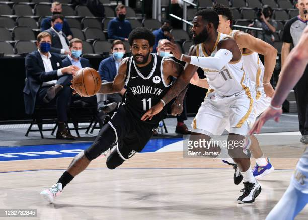 Kyrie Irving of the Brooklyn Nets drives to the basket during the game against the Dallas Mavericks on May 6, 2021 at the American Airlines Center in...