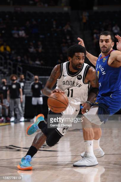 Kyrie Irving of the Brooklyn Nets drives to the basket during the game against the Denver Nuggets on May 8, 2021 at the Ball Arena in Denver,...