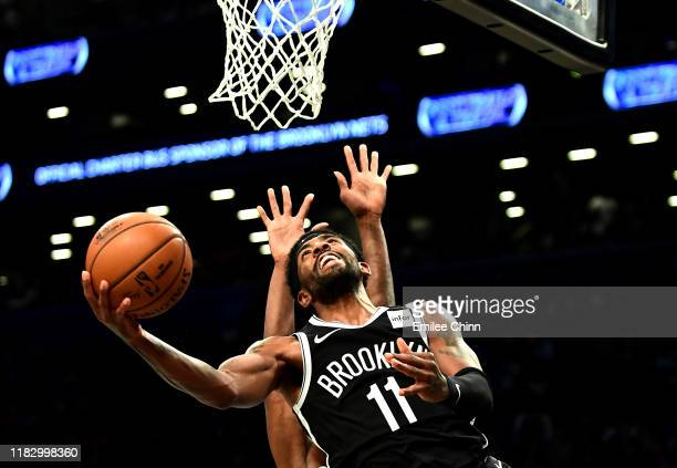 Kyrie Irving of the Brooklyn Nets goes in for a layup during the first half of their game against the Minnesota Timberwolves at Barclays Center on...