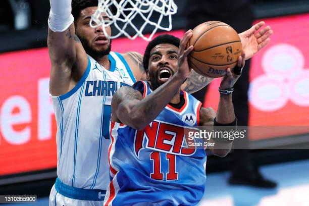 Kyrie Irving of the Brooklyn Nets goes to the basket against Miles Bridges of the Charlotte Hornets during the first half at Barclays Center on April...