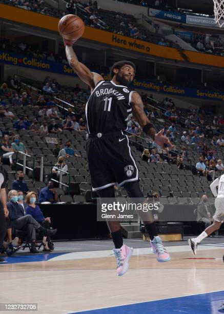Kyrie Irving of the Brooklyn Nets grabs a rebound during the game against the Dallas Mavericks on May 6, 2021 at the American Airlines Center in...
