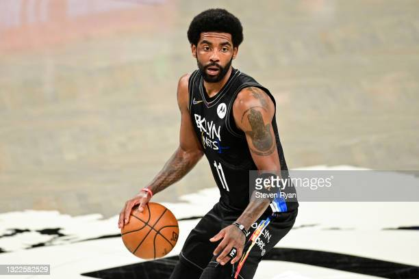 Kyrie Irving of the Brooklyn Nets handles the ball against the Milwaukee Bucks in Game Two of the Second Round of the 2021 NBA Playoffs at Barclays...