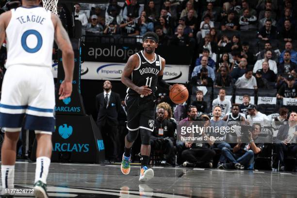 Kyrie Irving of the Brooklyn Nets handles the ball against the Minnesota Timberwolves on October 23, 2019 at Barclays Center in Brooklyn, New York....