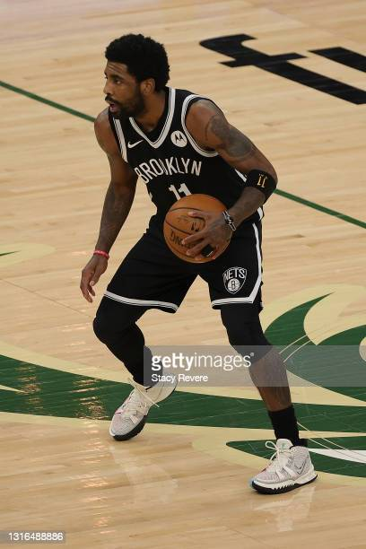 Kyrie Irving of the Brooklyn Nets handles the ball during a game against the Milwaukee Bucks at Fiserv Forum on May 04, 2021 in Milwaukee, Wisconsin....