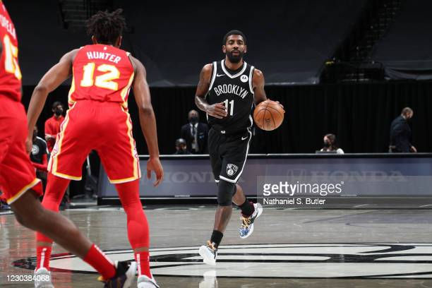 Kyrie Irving of the Brooklyn Nets handles the ball during the game against the Atlanta Hawks on January 1, 2021 at Barclays Center in Brooklyn, New...