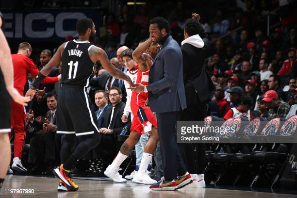 Kyrie Irving of the Brooklyn Nets highfives John Wall of the Washington Wizards before the game on February 1 2020 at Capital One Arena in Washington...