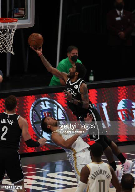 Kyrie Irving of the Brooklyn Nets is fouled by Jalen Brunson of the Dallas Mavericks in the fourth quarter at American Airlines Center on May 06,...