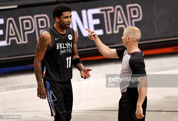 Kyrie Irving of the Brooklyn Nets is issued a double technical foul and ejected from the game in the third quarter by referee Tyler Ford at Barclays...