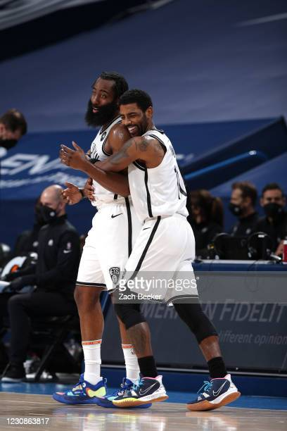 Kyrie Irving of the Brooklyn Nets & James Harden of the Brooklyn Nets hug during the game against the Oklahoma City Thunder on January 29, 2021 at...