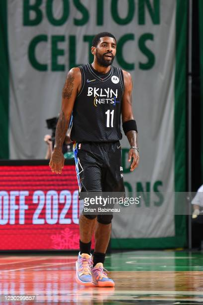 Kyrie Irving of the Brooklyn Nets looks on during a game against the Boston Celtics on December 25, 2020 at the TD Garden in Boston, Massachusetts....