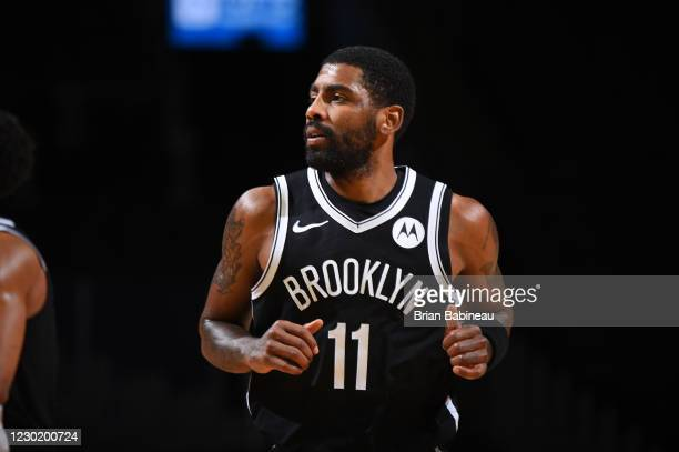 Kyrie Irving of the Brooklyn Nets looks on during a preseason game against the Boston Celtics on December 18, 2020 at the TD Garden in Boston,...