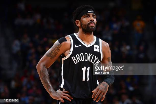 Kyrie Irving of the Brooklyn Nets looks on during the game against the Denver Nuggets on November 14, 2019 at the Pepsi Center in Denver, Colorado....