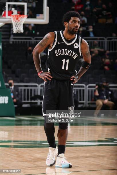 Kyrie Irving of the Brooklyn Nets looks on during the game against the Milwaukee Bucks on May 4, 2021 at the Fiserv Forum Center in Milwaukee,...
