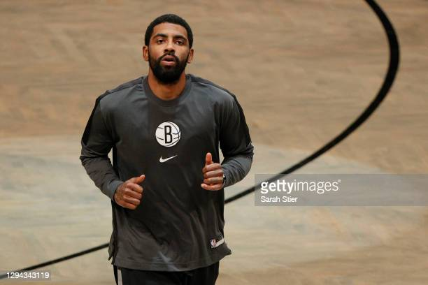 Kyrie Irving of the Brooklyn Nets looks on during warmups before the game against the Washington Wizards at Barclays Center on January 03, 2021 in...