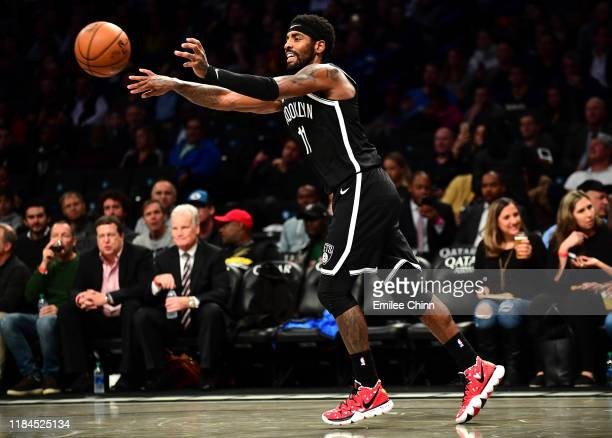Kyrie Irving of the Brooklyn Nets passes the ball during the second half of their game against the Indiana Pacers at Barclays Center on October 30...