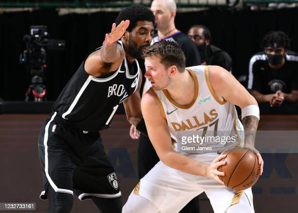 Kyrie Irving of the Brooklyn Nets plays defense on Luka Doncic of the Dallas Mavericks during the game on May 6, 2021 at the American Airlines Center...