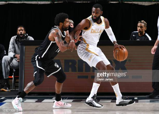 Kyrie Irving of the Brooklyn Nets plays defense on Tim Hardaway Jr. #11 of the Dallas Mavericks during the game on May 6, 2021 at the American...