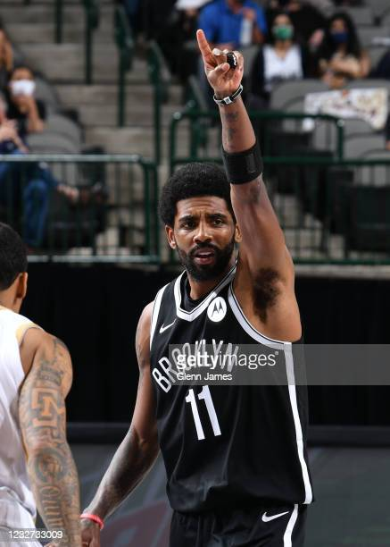 Kyrie Irving of the Brooklyn Nets points during the game against the Dallas Mavericks on May 6, 2021 at the American Airlines Center in Dallas,...
