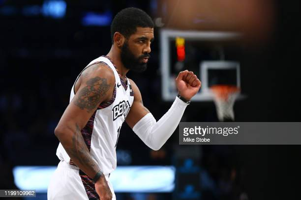 Kyrie Irving of the Brooklyn Nets pumps his fist against the against the Atlanta Hawks at Barclays Center on January 12 2020 in New York City...