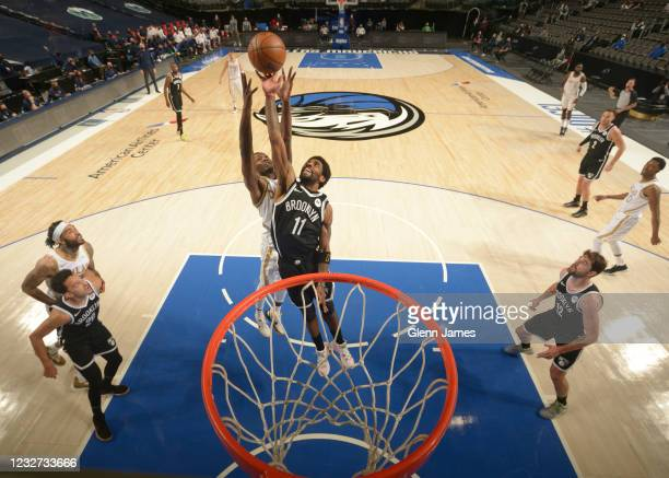 Kyrie Irving of the Brooklyn Nets reaches for a rebound during the game against the Dallas Mavericks on May 6, 2021 at the American Airlines Center...