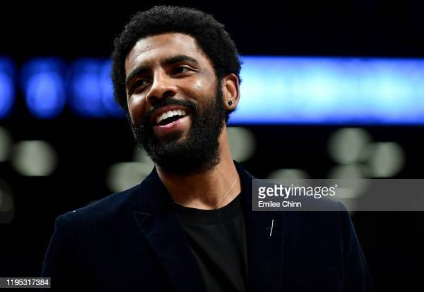Kyrie Irving of the Brooklyn Nets reacts after a basket during the second half of their game against the Atlanta Hawks at Barclays Center on December...