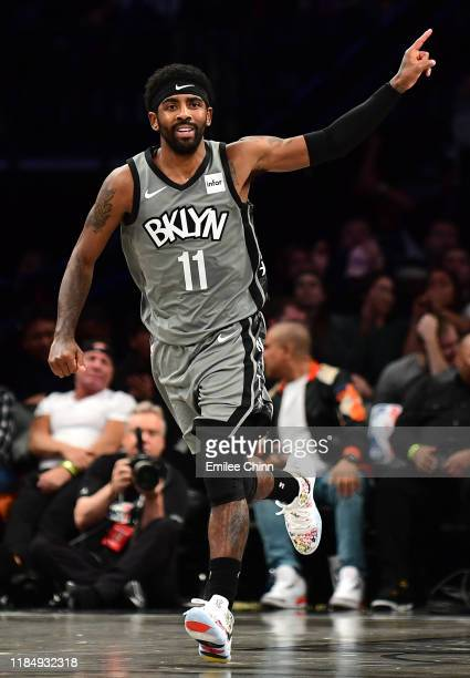 Kyrie Irving of the Brooklyn Nets reacts during the first half of their game against the Houston Rockets at Barclays Center on November 01, 2019 in...