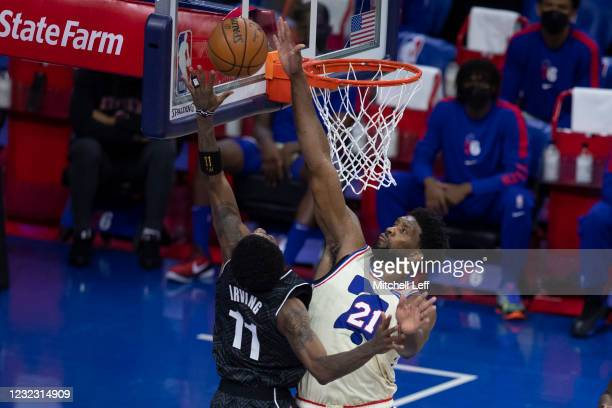 Kyrie Irving of the Brooklyn Nets shoots the ball against Joel Embiid of the Philadelphia 76ers in the third quarter at the Wells Fargo Center on...