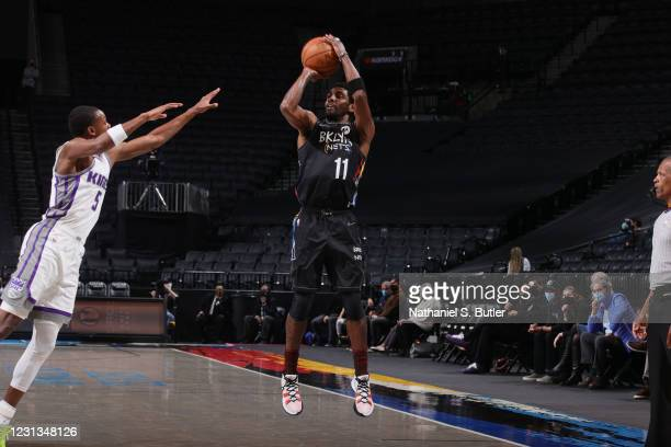 Kyrie Irving of the Brooklyn Nets shoots the ball during the game against the Sacramento Kings on February 23, 2021 at Barclays Center in Brooklyn,...