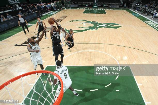 Kyrie Irving of the Brooklyn Nets shoots the ball during the game against the Milwaukee Bucks on May 4, 2021 at the Fiserv Forum Center in Milwaukee,...