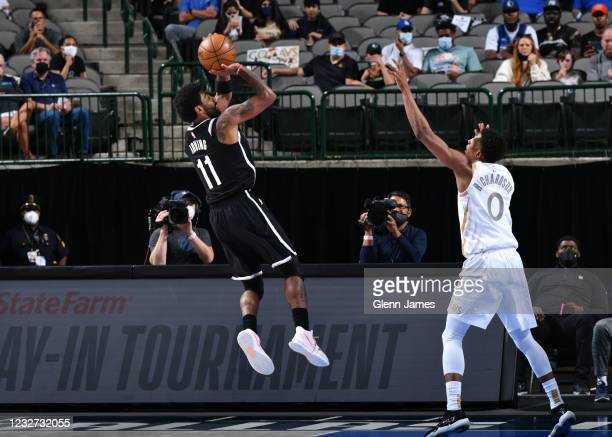 Kyrie Irving of the Brooklyn Nets shoots the ball during the game against the Dallas Mavericks on May 6, 2021 at the American Airlines Center in...