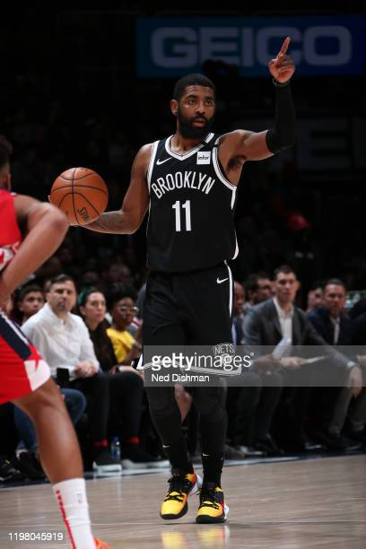 Kyrie Irving of the Brooklyn Nets signals to a teammate during the game against the Washington Wizards on February 1 2020 at Capital One Arena in...
