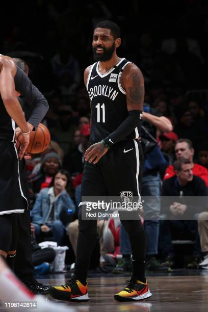 Kyrie Irving of the Brooklyn Nets smiles during the game against the Washington Wizards on February 1 2020 at Capital One Arena in Washington DC NOTE...