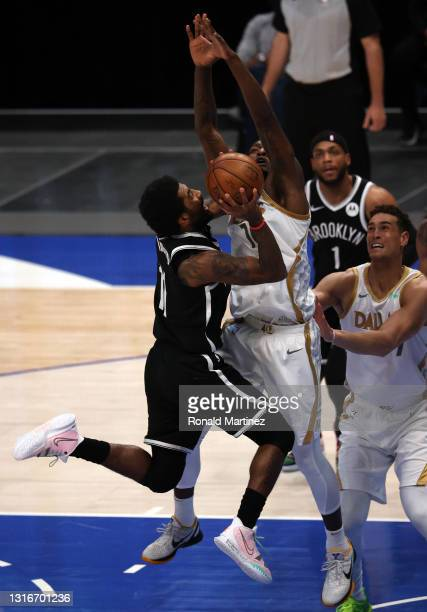 Kyrie Irving of the Brooklyn Nets takes a shot against Dorian Finney-Smith of the Dallas Mavericks in the first quarter at American Airlines Center...