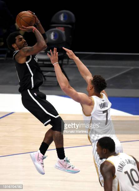 Kyrie Irving of the Brooklyn Nets takes a shot against Dwight Powell of the Dallas Mavericks in the second quarter at American Airlines Center on May...