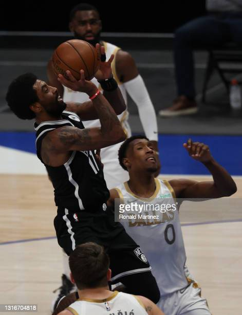 Kyrie Irving of the Brooklyn Nets takes a shot against Josh Richardson of the Dallas Mavericks in the second quarter at American Airlines Center on...