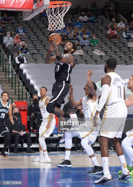 Kyrie Irving of the Brooklyn Netsshoots the ball during the game against the Dallas Mavericks on May 6, 2021 at the American Airlines Center in...