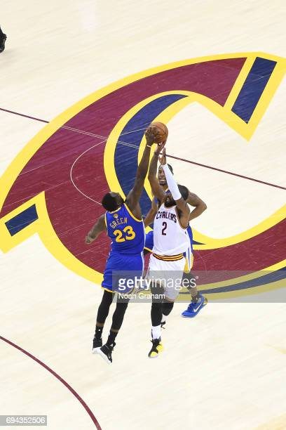 Kyrie Irving of the Cleveland Cavaliers and Draymond Green of the Golden State Warriors jump for the ball in Game Three of the 2017 NBA Finals on...