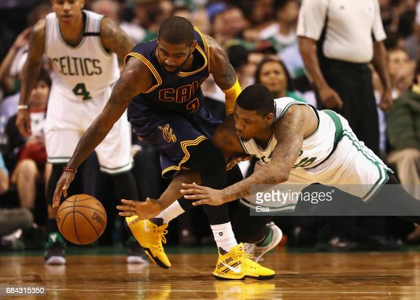 Kyrie Irving of the Cleveland Cavaliers and Marcus Smart of the Boston Celtics battle for the ball in the second half during Game One of the 2017 NBA...