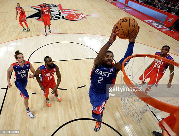 Kyrie Irving of the Cleveland Cavaliers and the Eastern Conference goes up for a dunk during the 2013 NBA AllStar game at the Toyota Center on...