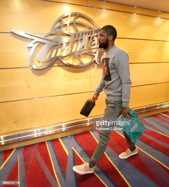 Kyrie Irving of the Cleveland Cavaliers arrives to the arena before the game against the Boston Celtics in Game Three of the Eastern Conference...