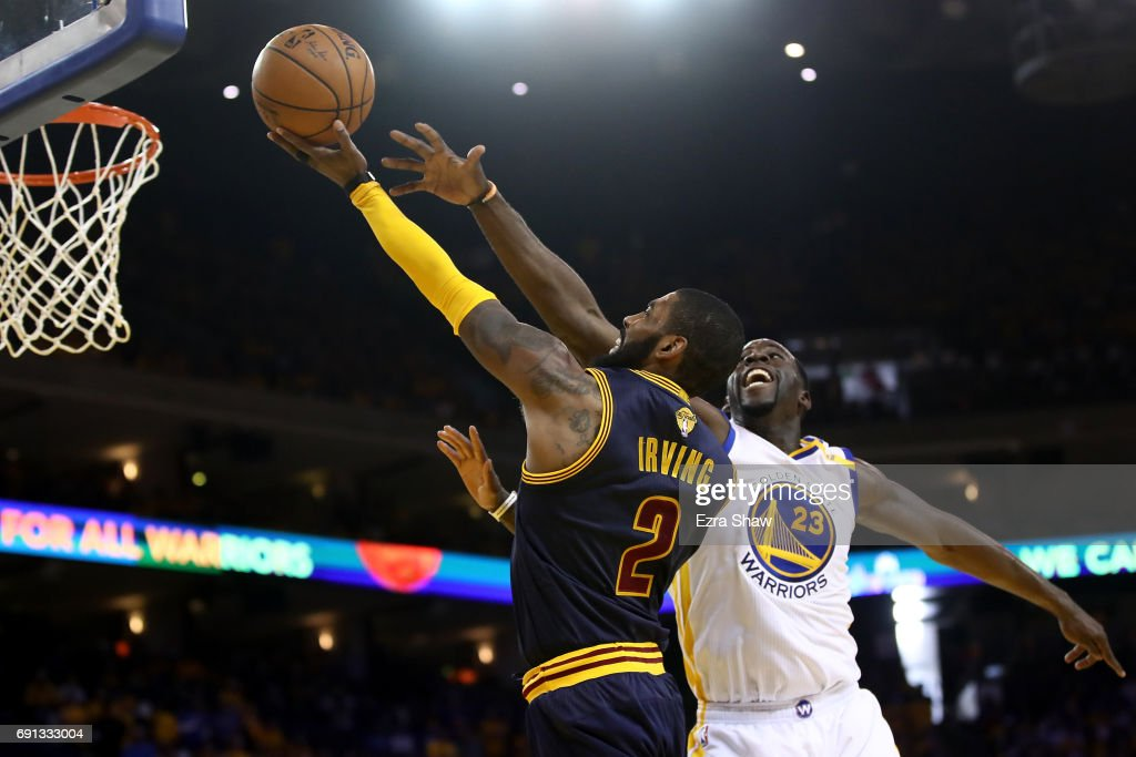 Kyrie Irving #2 of the Cleveland Cavaliers attempts a shot defended by Draymond Green #23 of the Golden State Warriors in Game 1 of the 2017 NBA Finals at ORACLE Arena on June 1, 2017 in Oakland, California.
