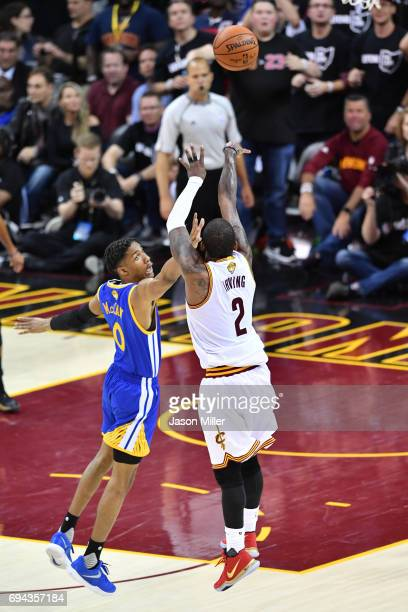 Kyrie Irving of the Cleveland Cavaliers attempts a shot defended by Patrick McCaw of the Golden State Warriors in Game 4 of the 2017 NBA Finals at...