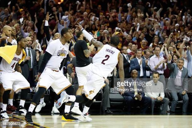 Kyrie Irving of the Cleveland Cavaliers celebrates a basket late in the fourth quarter of their 112 to 99 win over the Boston Celtics during Game...