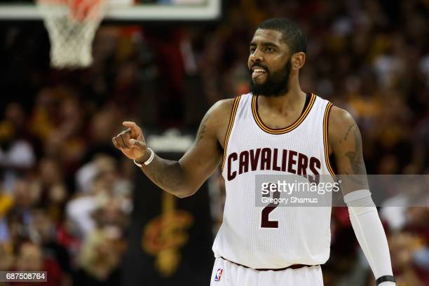 Kyrie Irving of the Cleveland Cavaliers celebrates late in the fourth quarter of their 112 to 99 win over the Boston Celtics during Game Four of the...