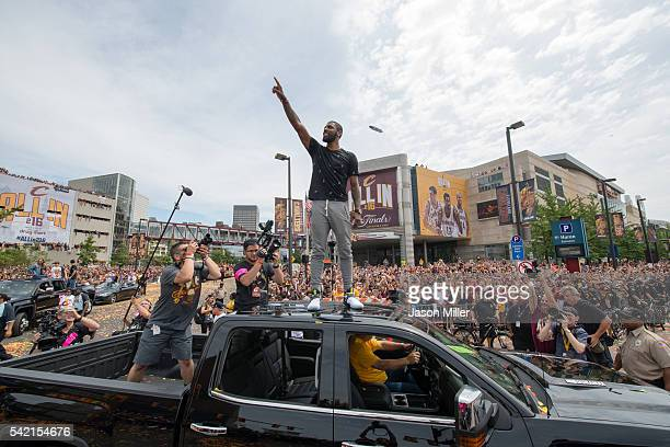 Kyrie Irving of the Cleveland Cavaliers celebrates with fans during the Cleveland Cavaliers 2016 championship victory parade and rally on June 22...